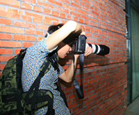 型男摄影师也很有范
