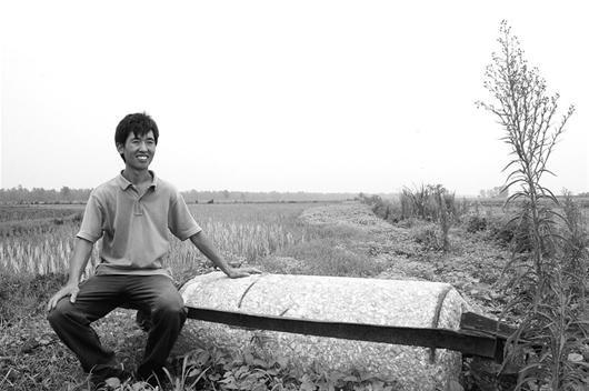 """图为:如今的李明攀,是一位""""异类""""而乐观的""""农场主"""""""