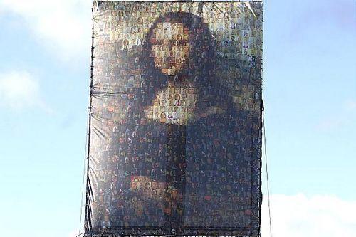 英国伦敦近日出现一幅巨型《蒙娜丽莎的微笑》,由83幅自画像拼接而成。