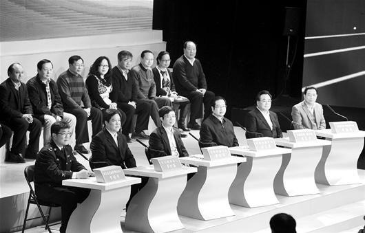 图为:电视问政后,相关部门的整改举措才是解决问题的关键 (记者邹斌摄)